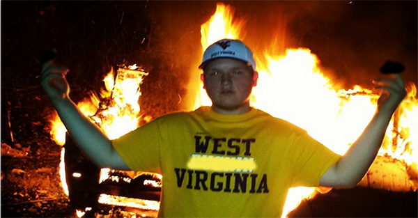 West Virginia fans burn things, cops launch tear gas in Morgantown after the Mountaineers upset Baylor