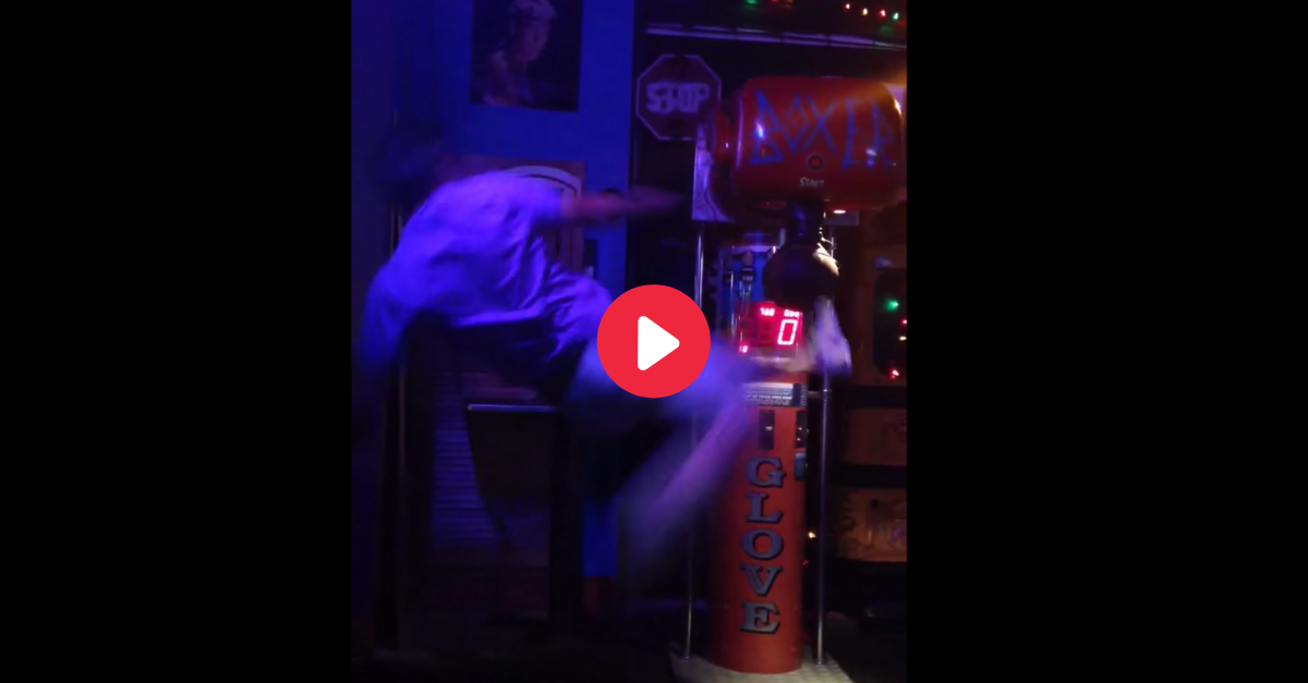 WATCH: Drunk Guy Hilariously Fails at Kicking Arcade Punching Machine