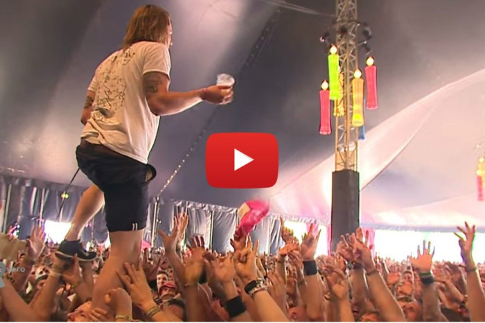 Singer catches flying cup of beer mid crowd surf then proceeds to chug it