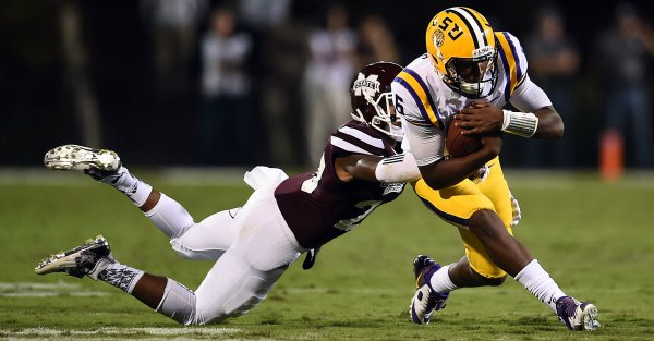Les Miles: Brandon Harris doesn't have the freedom to check plays at the line