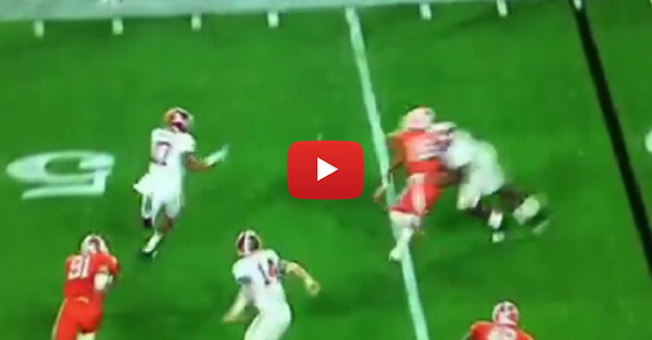 Alabama's Cam Robinson destroys a Clemson defender on a block