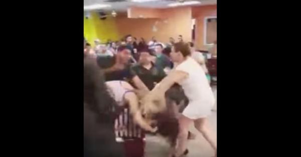 This hair-pulling, chair-throwing, fist-flying brawl happened for one incredibly stupid reason