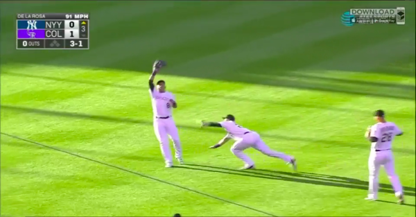 Gerarado Parra suffers ugly leg injury when he collides with Trevor Story on a shallow fly ball