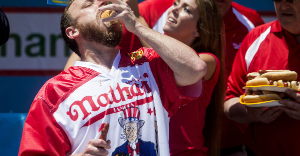 Joey Chestnut ate a ridiculous number of hot dogs in record-breaking performance
