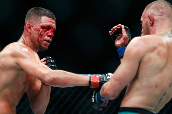 McGregor carves up Diaz and beats him bloody in one of the best UFC fights of all time