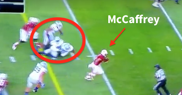 Christian McCaffrey's juke caused a three-player pile up on his way to the end zone