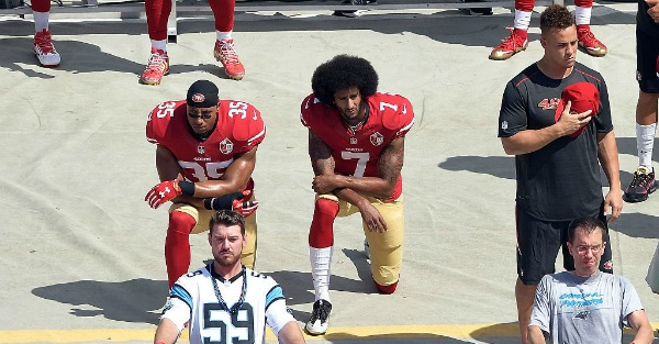 A high school player kneeled during the anthem, now the police are involved