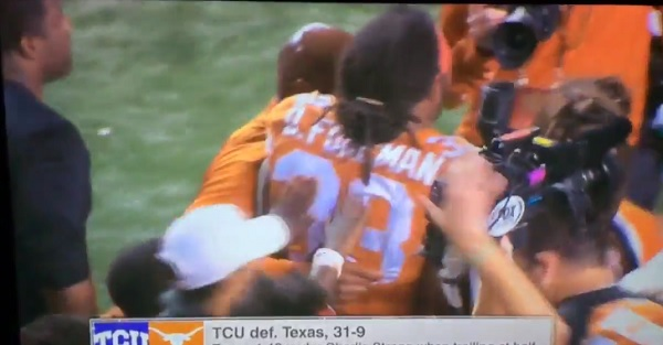 WATCH: Charlie Strong has to help a heartbroken D'Onta Foreman off the field after loss to TCU