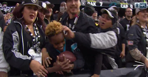 Raiders fan got way too aggressive, swatted a kid in the head