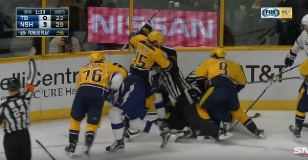 A brutal blindside hit leads to an all-out hockey brawl