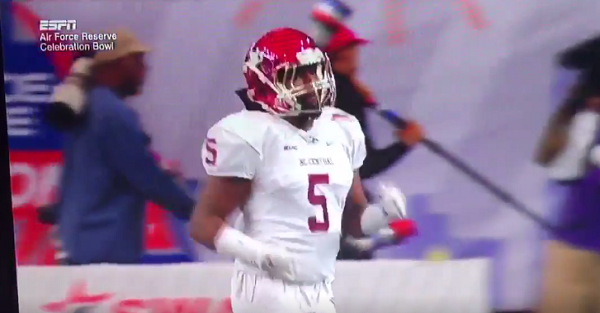 CFB player gets caught throwing NSFW gesture on national television
