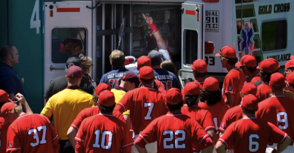 Baseball player taken away in ambulance after trying to steal a home run away