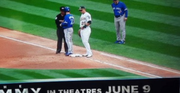 A movie ad quickly turned NSFW thanks to a snafu during a baseball game