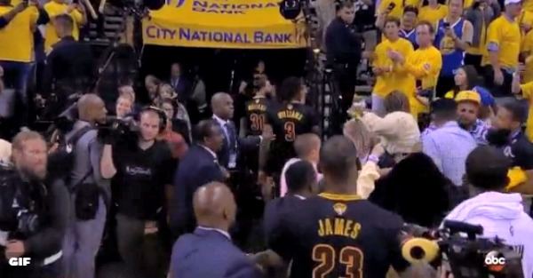 As LeBron James walked off the court, a fight erupted right in front of him