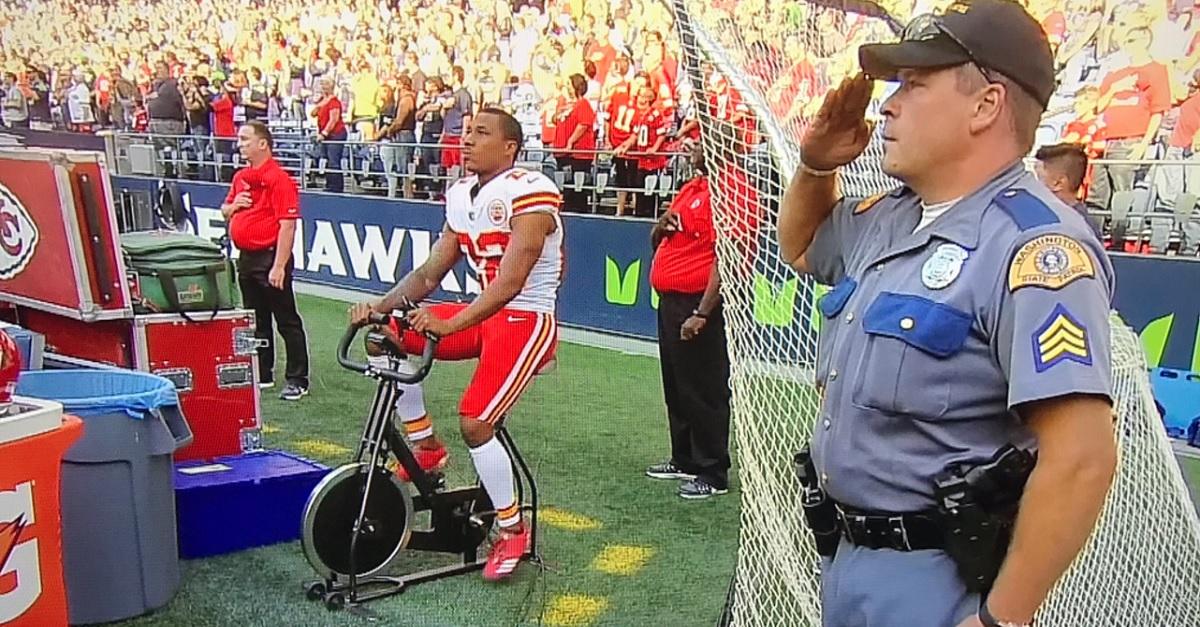 NFL player rides stationary bike during national anthem