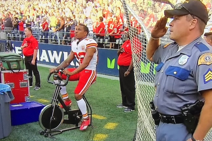 NFL player rides stationary bike during national anthem