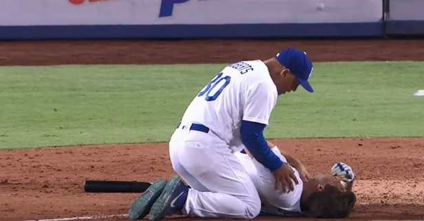 Pitcher collapses in agony after taking a fastball to the throat