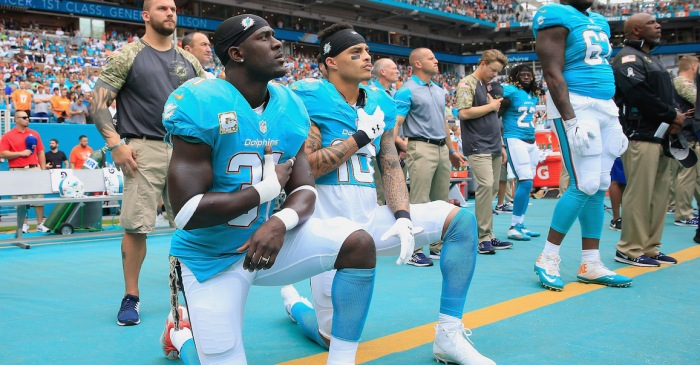 Less than a month after instituting national anthem policy, three players reverse course