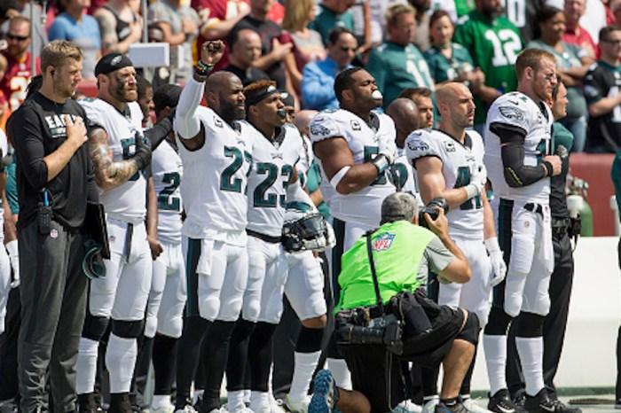 After blockbuster agreement, national anthem protesting NFL player plans to halt demonstration