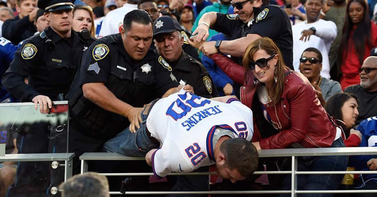 Fan faces felony charge for causing melee at NFL game