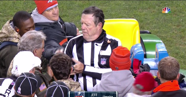 Umpire gets carted off the field after taking brutal hit on a punt return