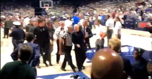 Cincinnati coach has to be restrained from going after a player after Crosstown Shootout loss