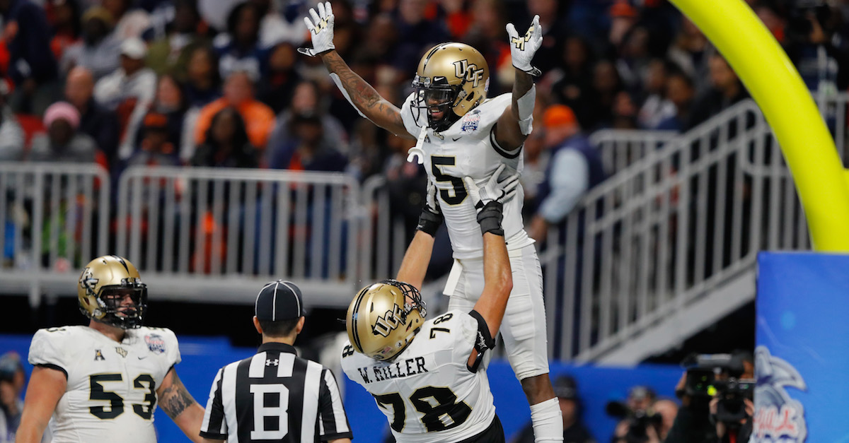 No. 12 UCF stuns No. 7 Auburn in massive Chick-Fil-A Peach Bowl upset