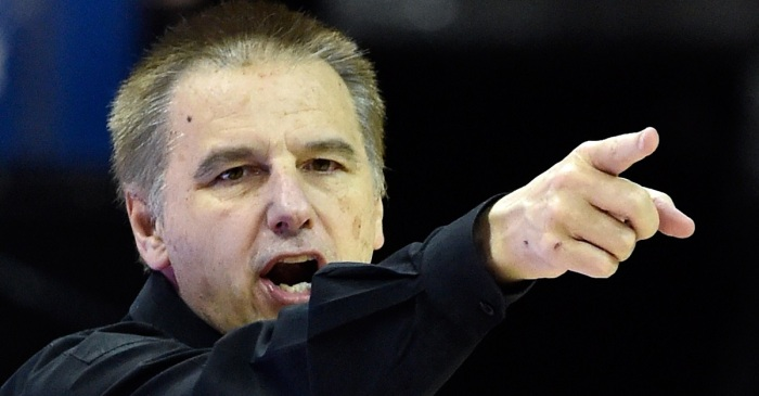 Embattled in scandal, basketball coach calls it quits