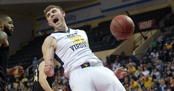 WATCH: WVU Player Ejected for Tripping While He's Riding the Bench