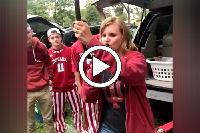 Wife Crushes Beer Bong at Tailgate While Husband Watches Proudly