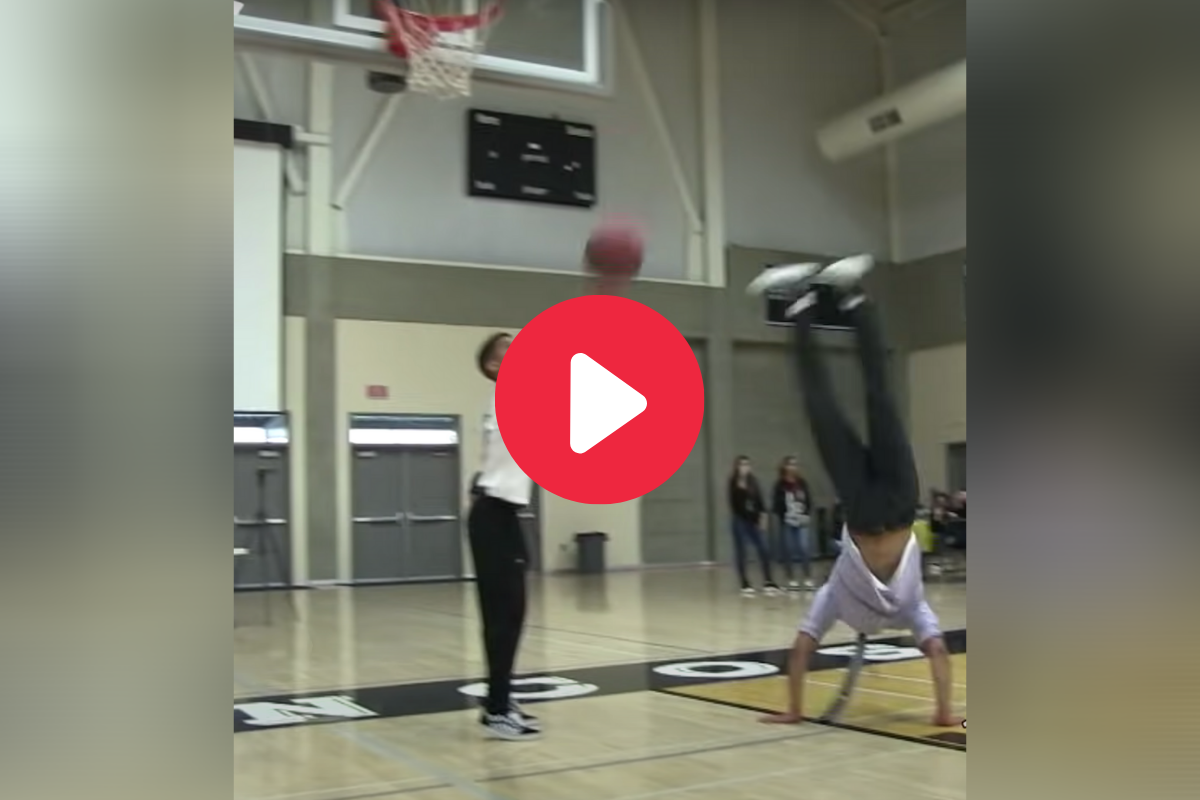 "Science Teacher's ""Backflip Dunk"" Wows Entire Student Body"