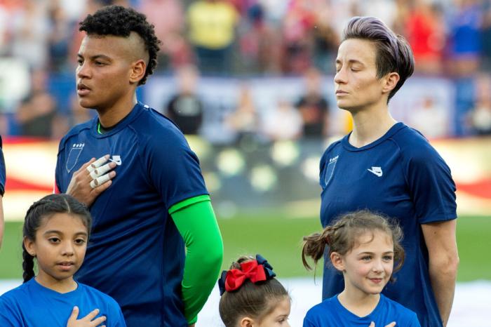 American Women Hide U.S. Soccer Logo During Anthem in Protest