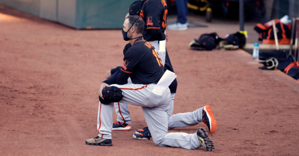 Giants Manager, Players Kneel During National Anthem