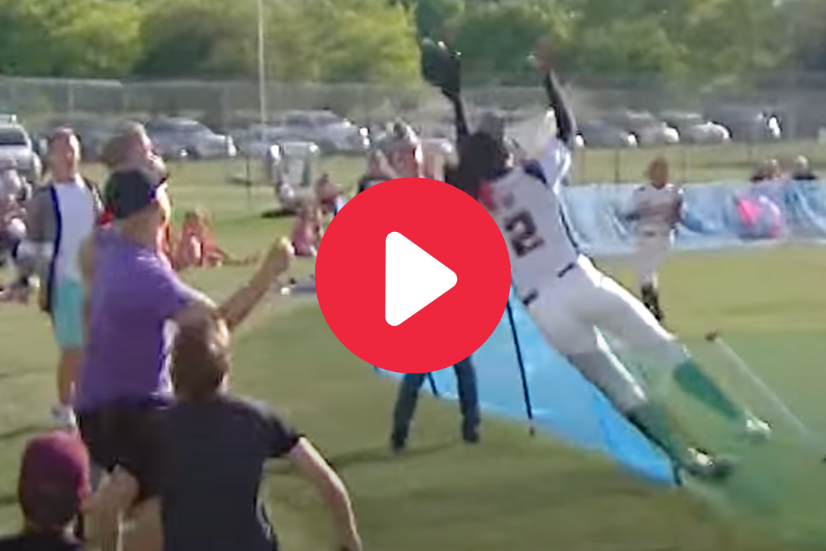 Softball Star Jumps Over Fence for Viral Home Run-Saving Catch