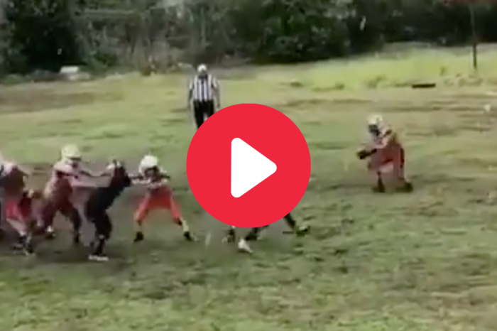 Punter Fumbles Snap in Rain, Ends Up Destroying Poor Defender