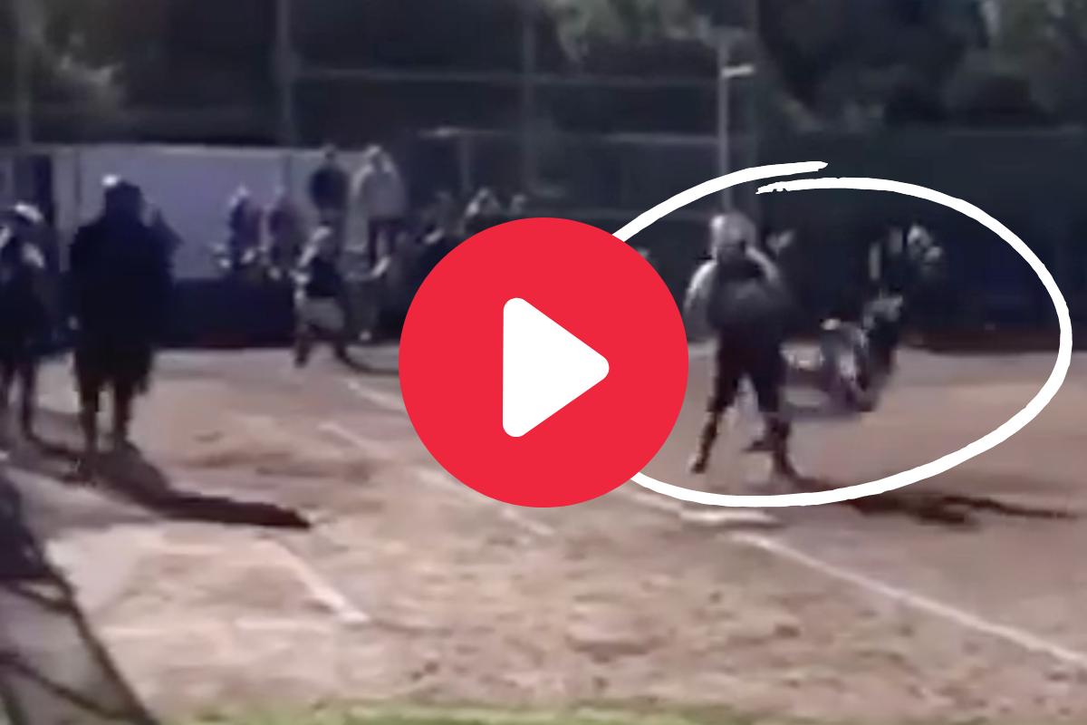 Softball Player Flattens Smaller First Baseman Into the Dirt
