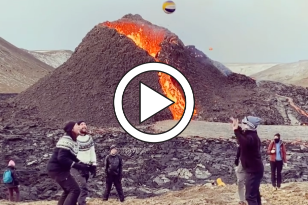 Daredevils Play Volleyball While Volcano Erupts Behind Them