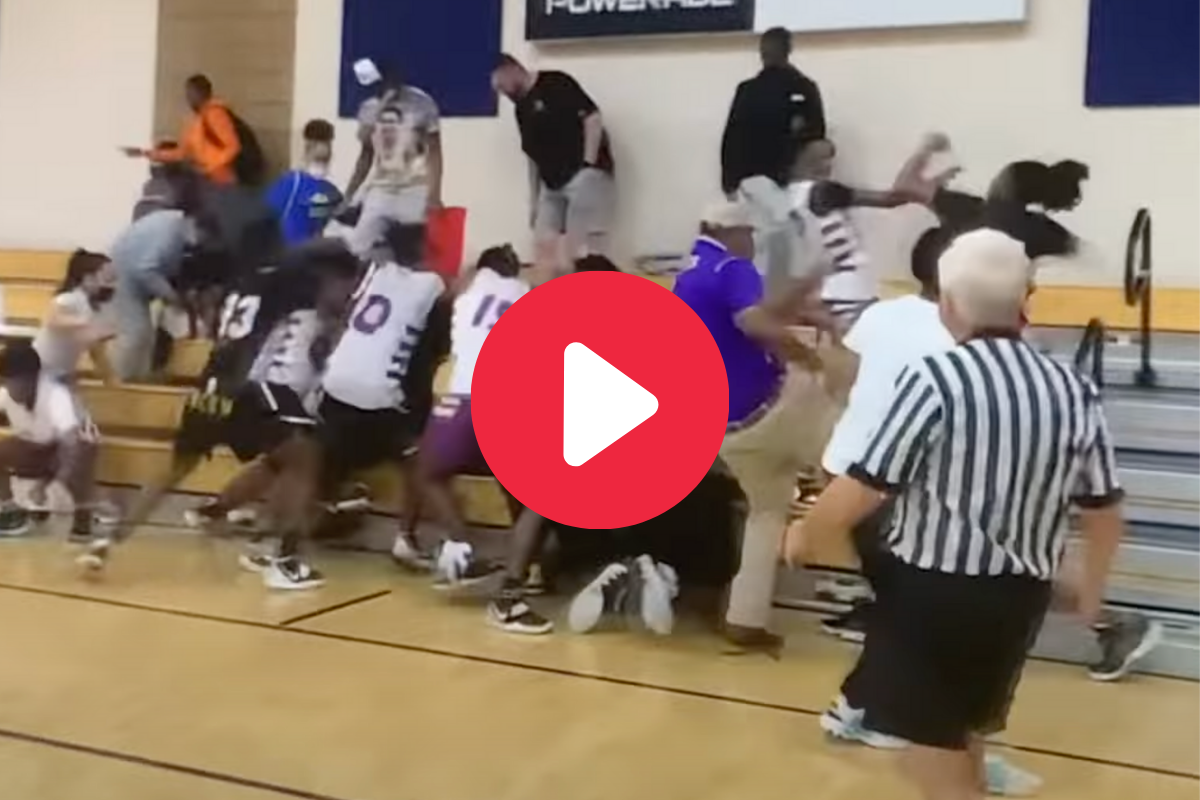 Parent Punches Opposing Player After Foul & Sparks Brawl